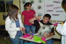 Spanish Club students build a pinata