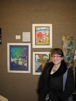danyelle cuellar poses with artwork