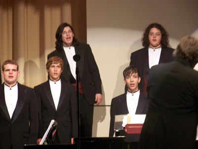 Mens choir performs in Auditorium