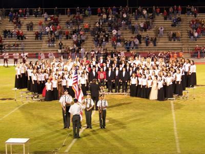All students perform on the football field